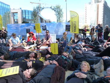 Activists at the demonstration lie on the ground in protest