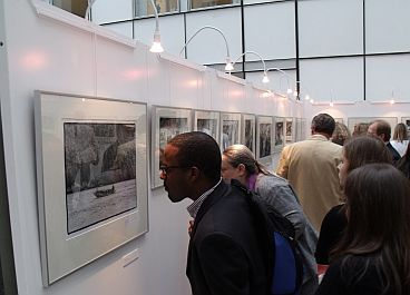 Visitors look at Den Blanken's photos