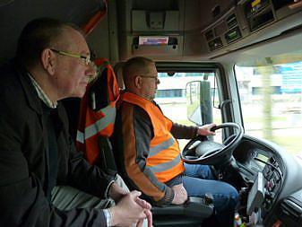 Dennis de Jong with a truck driver